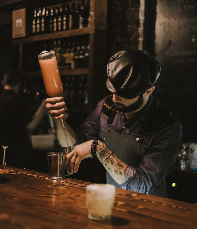 A man pouring cocktails