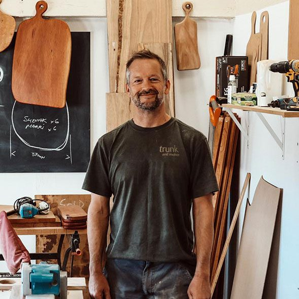 Miles from trunk & Maker in his workshop